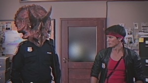 Renegade cop Kung Fury meats his strait-laced new partner Triceracop. No really, that's the whole joke.